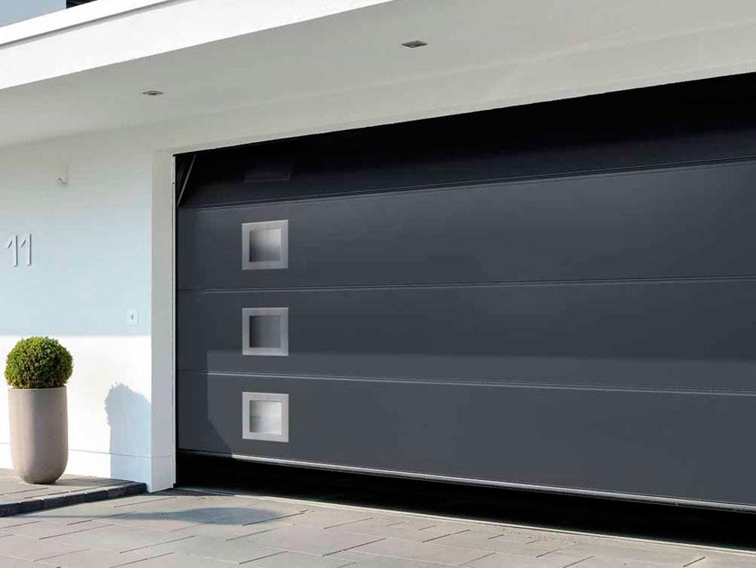 fabricación e instalación de amplia gama de puertas de garaje, seccionales, enrollables, artísticas, basculantes